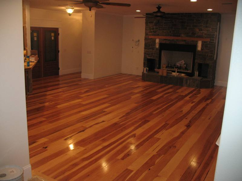 Should you choose a hardwood floor for your bend oregon home for Homes with wood tile floors