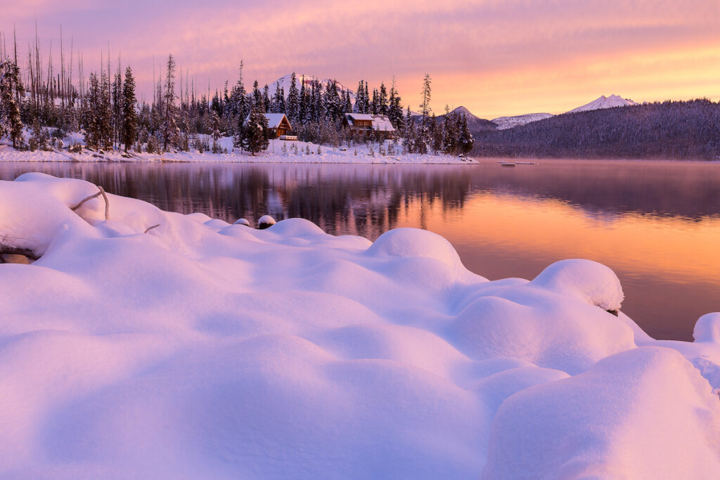 Elk Lake Cabin in the snow at sunset by Rich Bacon