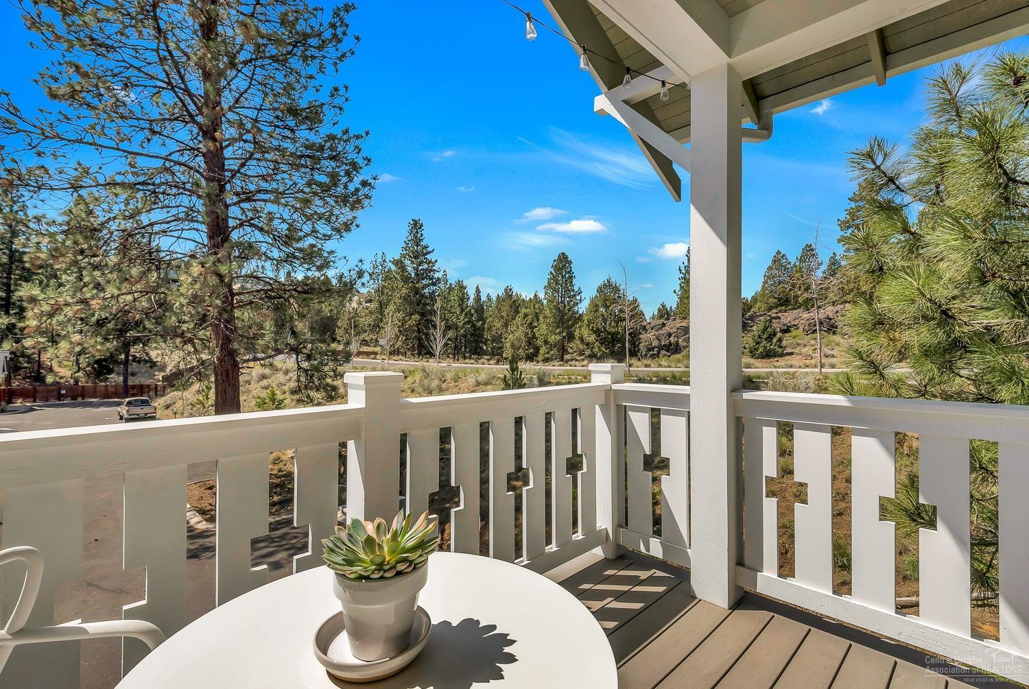 covered deck with white railing overlooking natural landscape in Bend, Oregon