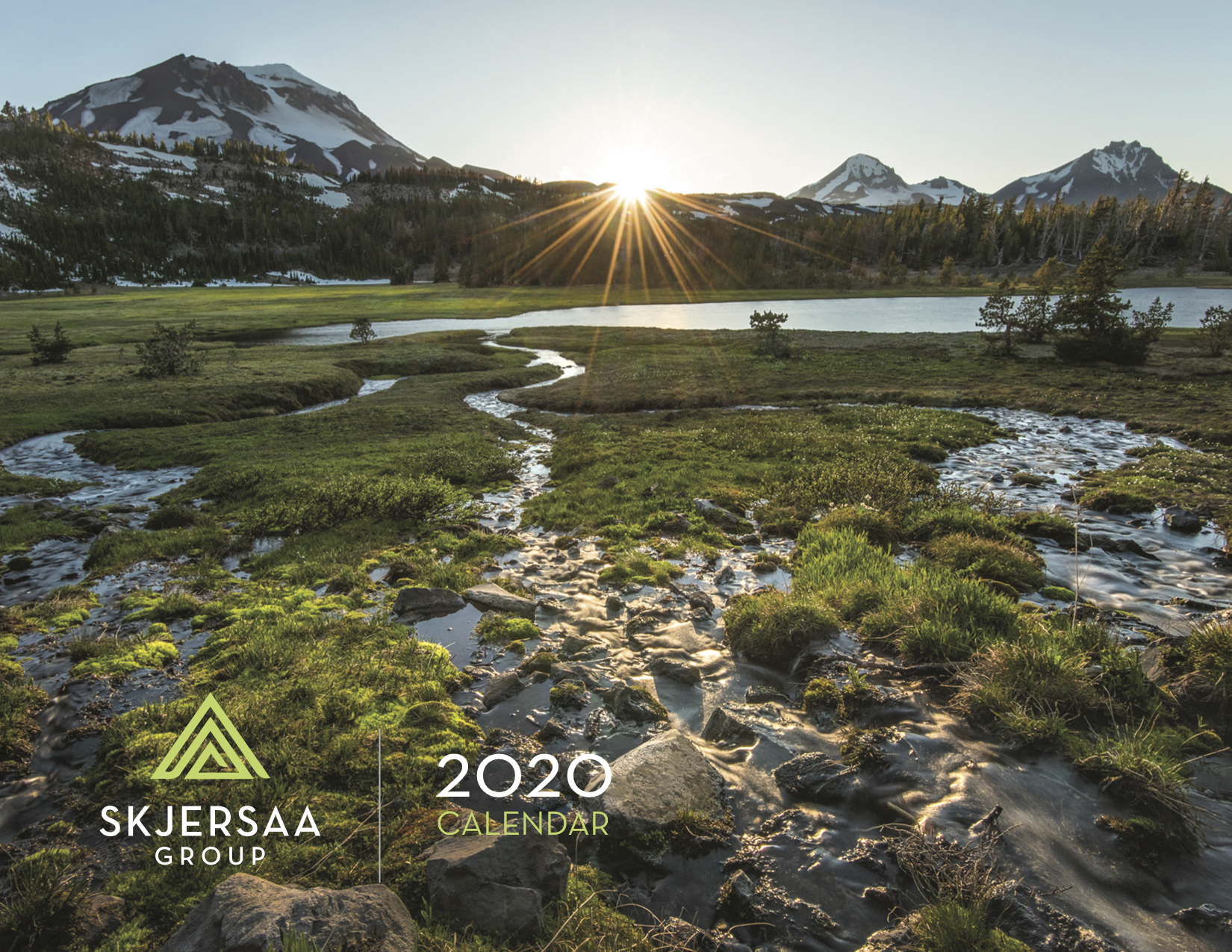 Cover of the 2020 Skjersaa Group annual print calendar featuring landscape photo of the Three Sisters peaks
